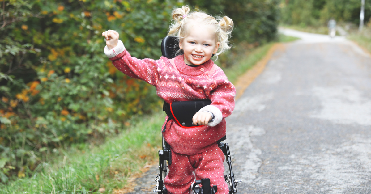 Ella smiling in her NF-Walker