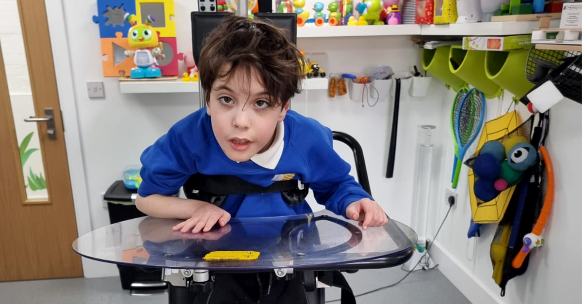 Young boy standing in the Innowalk Pro in a clinic